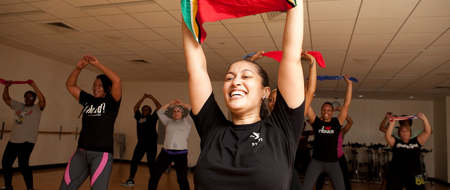 A teacher leads her group fitness dance class at the YMCA.