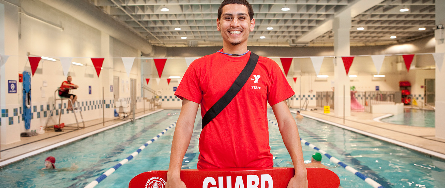 Lifeguard working at a YMCA pool in Brooklyn