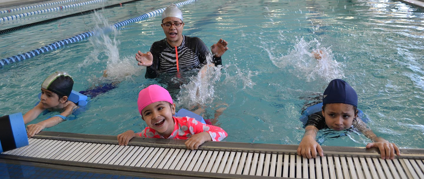 Adaptive swim class for kids at indoor pool in Bronx YMCA