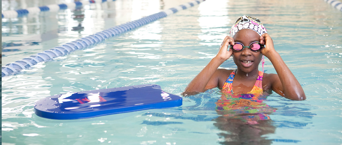 Kid learning how to swim at YMCA in Brooklyn