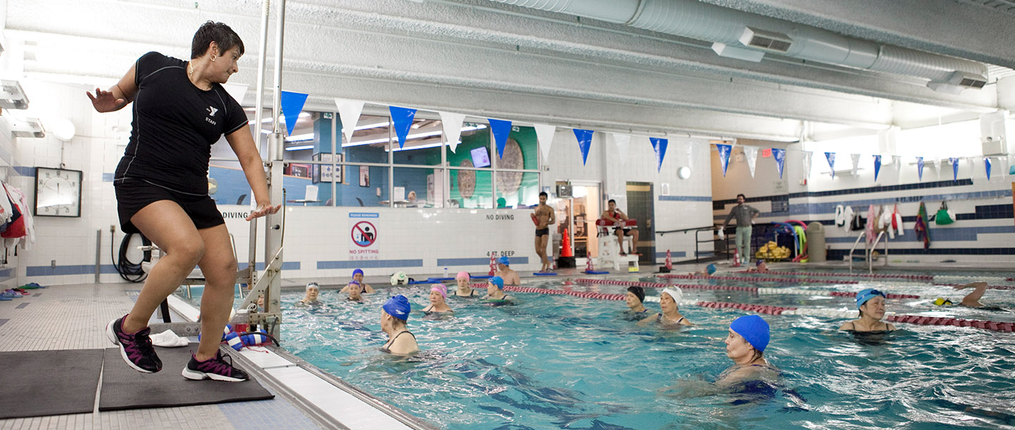 Adults taking water exercise class in the pool at the Chinatown YMCA in Manhattan