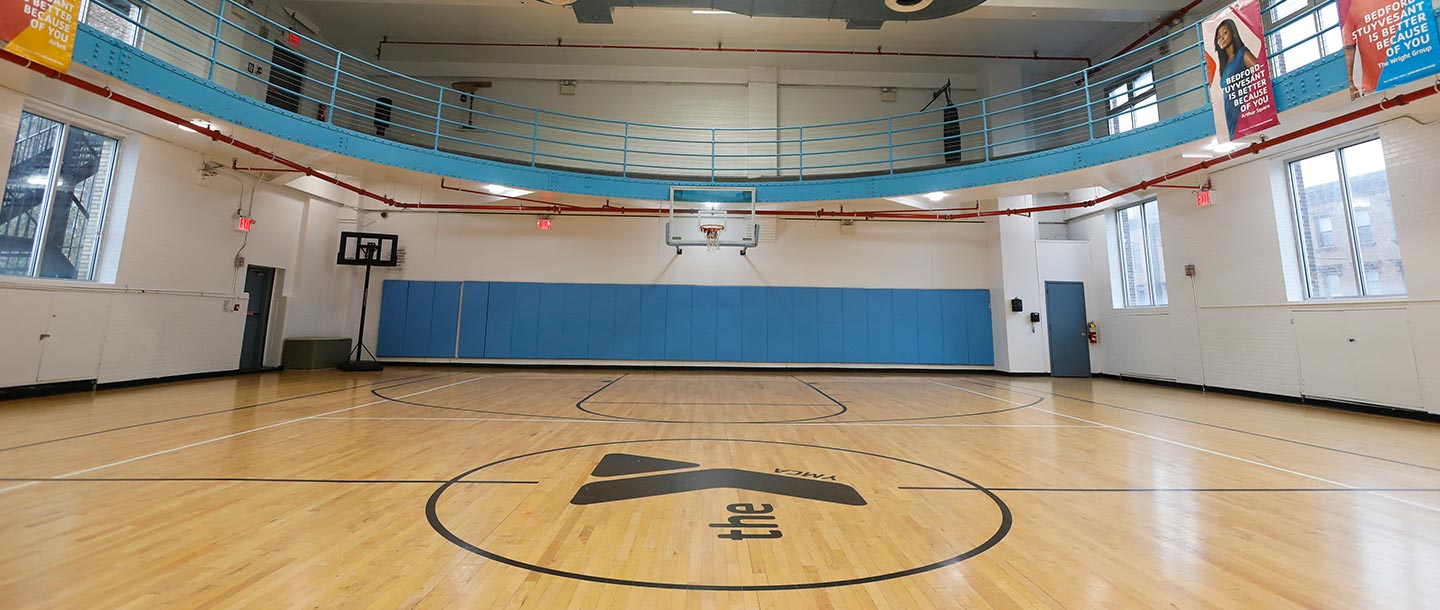 Indoor basketball courts and running track at Bed Stuy YMCA in Brooklyn