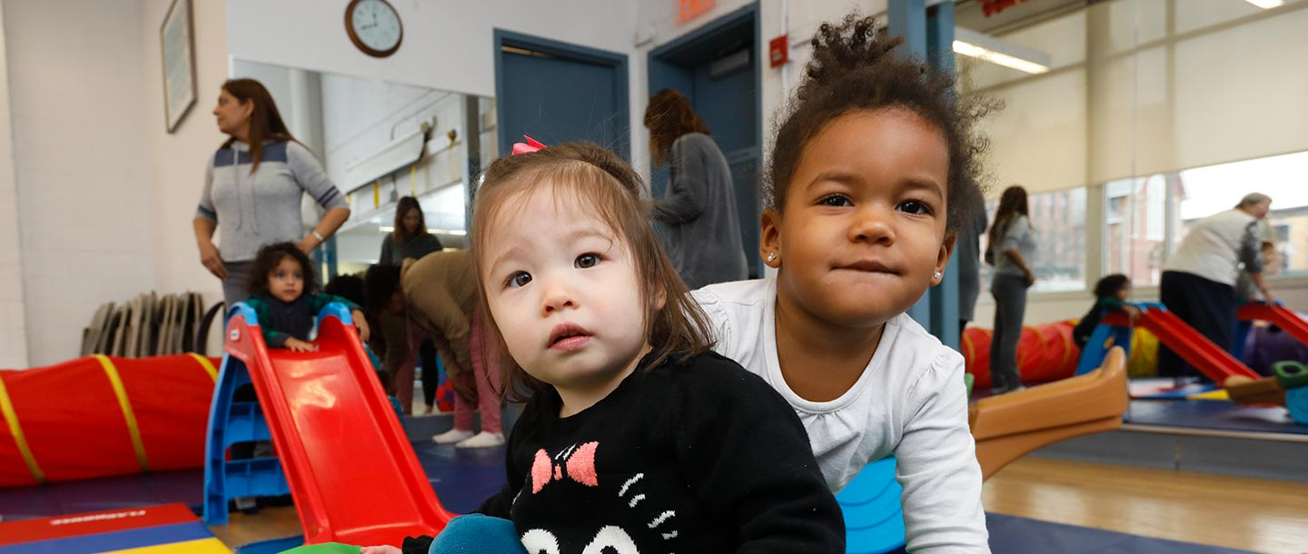 Two girls playing in Bed Stuy YMCA playroom for families