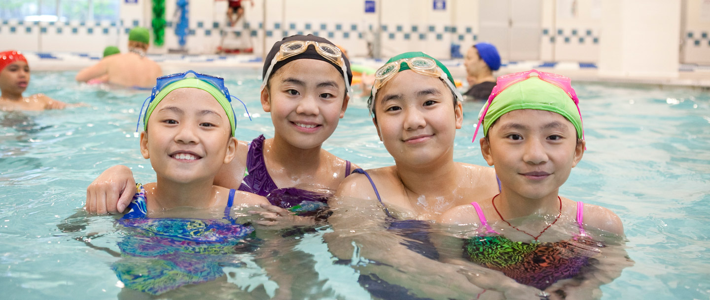 Four girls swimming at the Coney Island YMCA