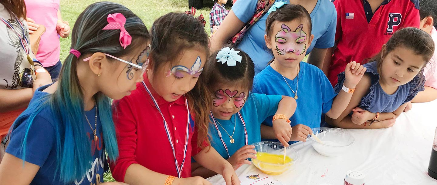 Kids with faces painted at YMCA community event