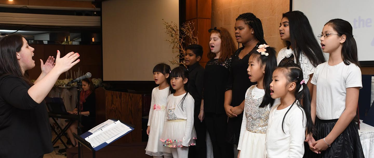 Children singing at Flushing YMCA event