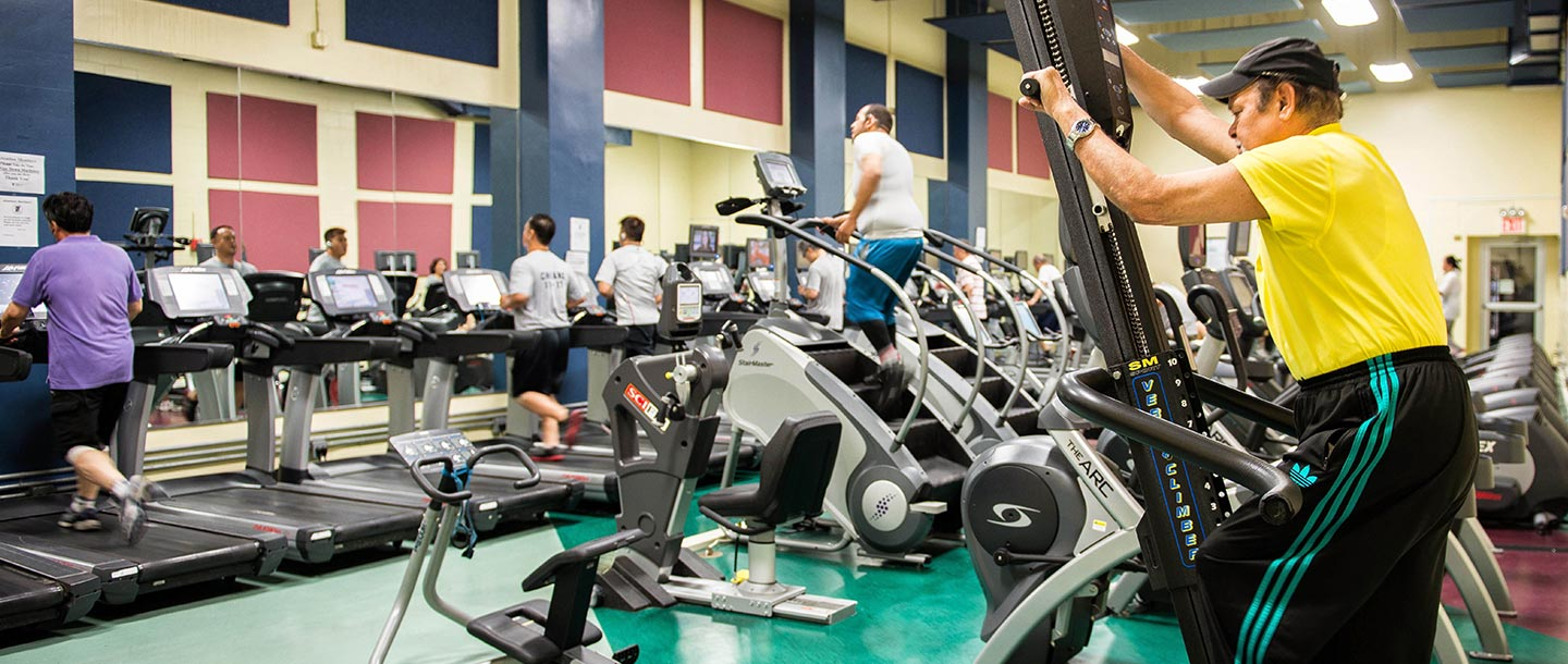 Fitness center cardio equipment at Flushing YMCA