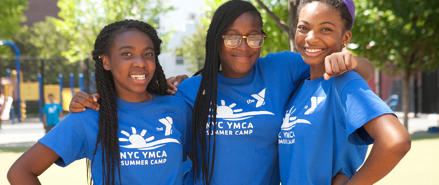 Three girls at YMCA summer day camp.