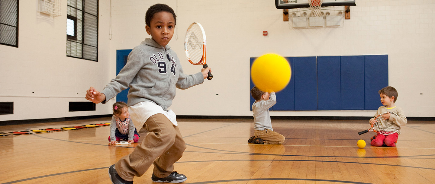 A child plays ball in the gymnasium at the YMCA.