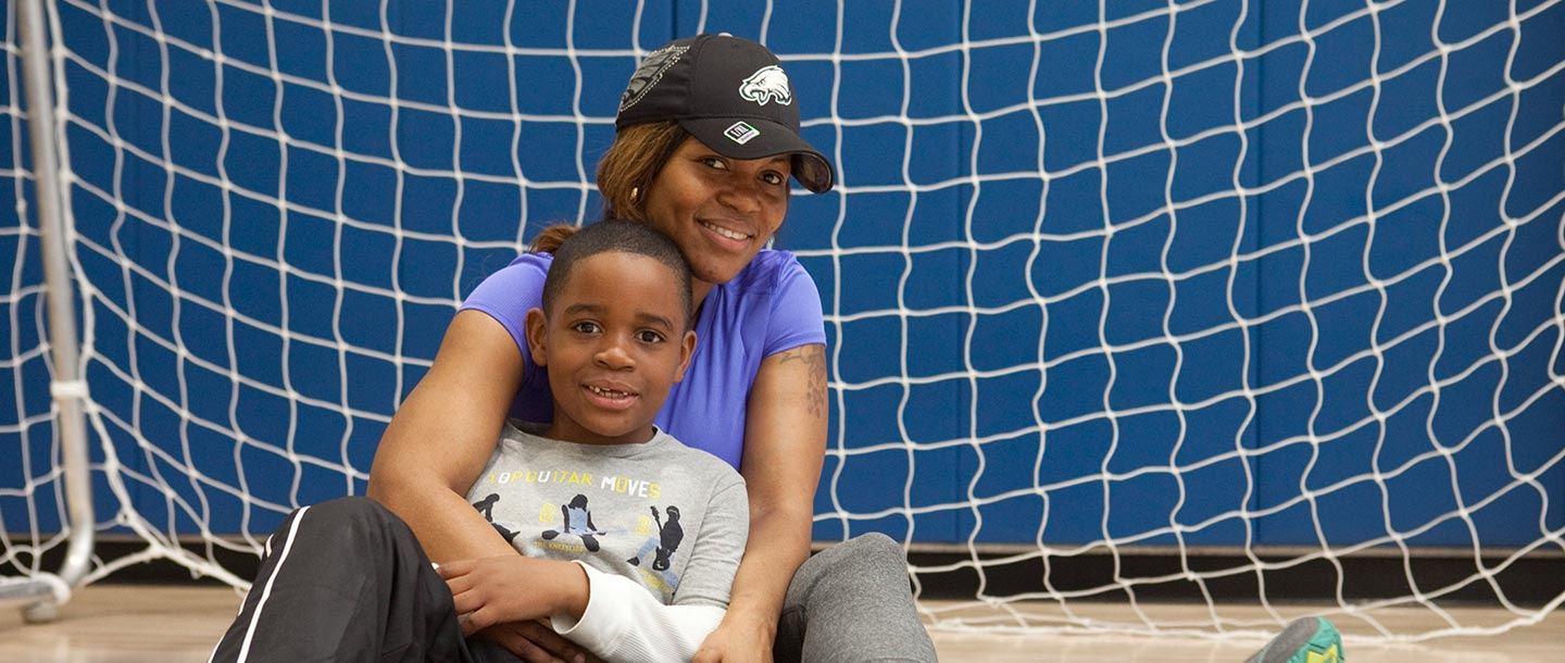 Mother and son in gymnasium at YMCA