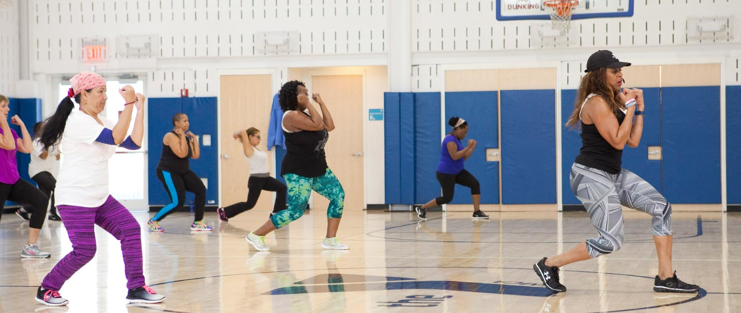 Group exercise instructor teaches YMCA fitness class