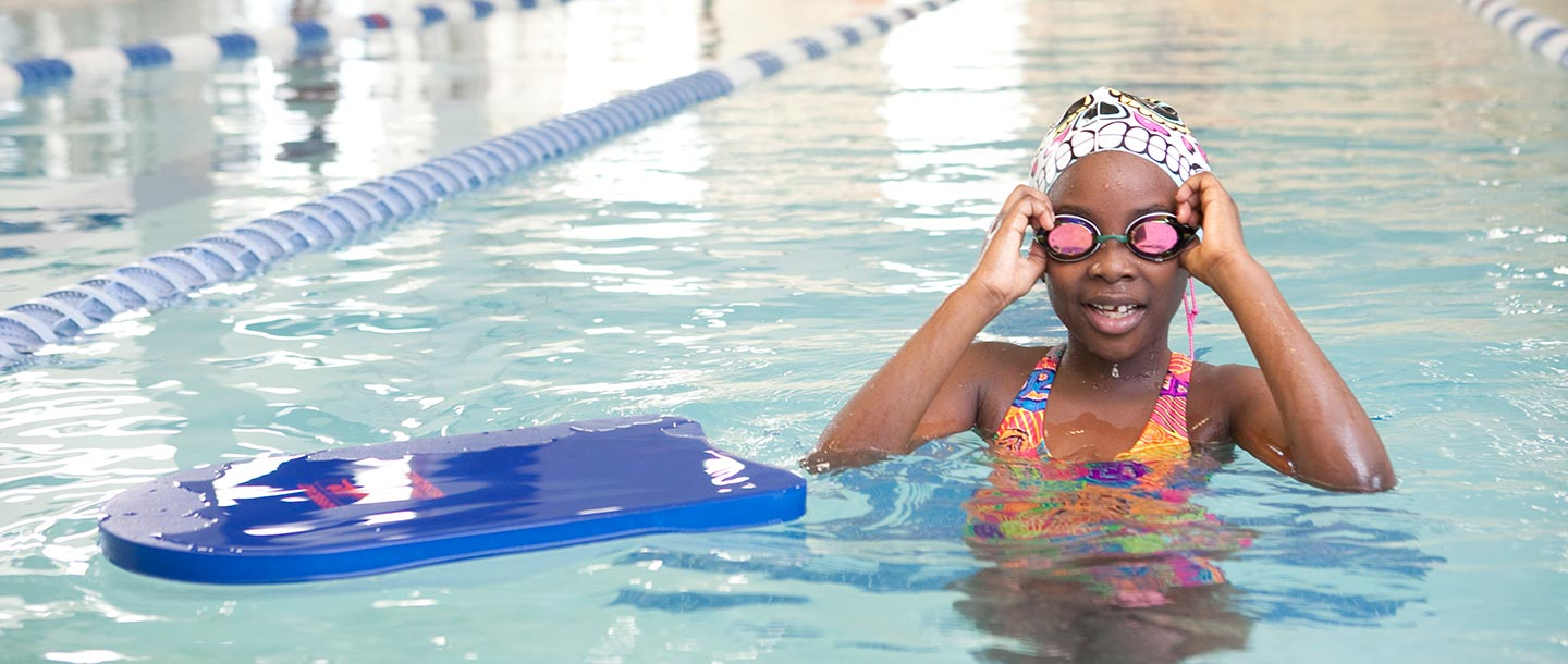 A child in the pool at the YMCA during swim classes.