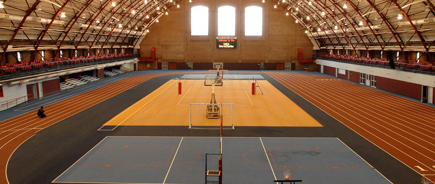 Indoor basketball court and track at the Park Slope Armory YMCA.