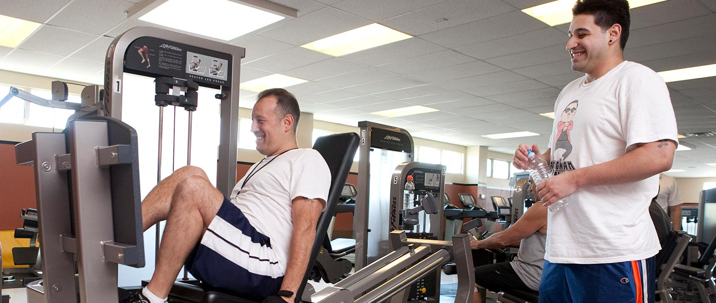 Two members working out on the fitness equipment at South Shore YMCA