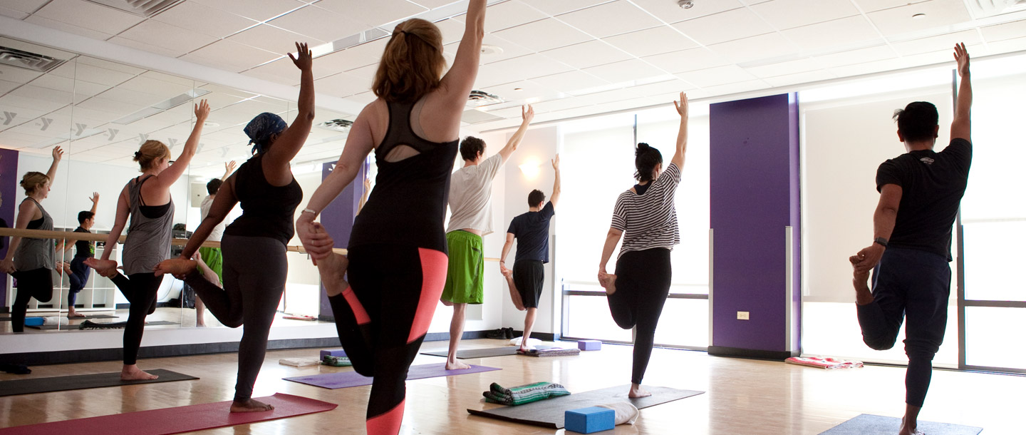 Group yoga fitness class at YMCA