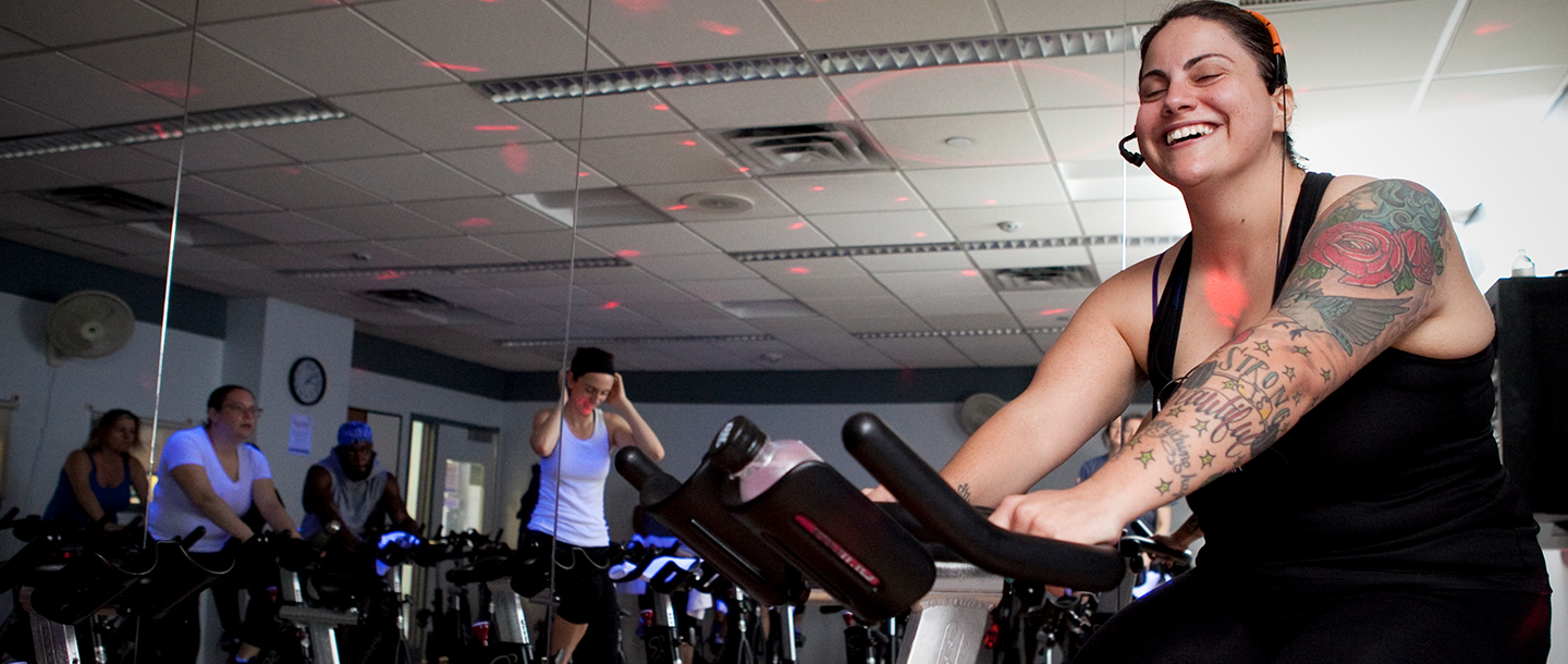 An YMCA instructor leads a spin class.