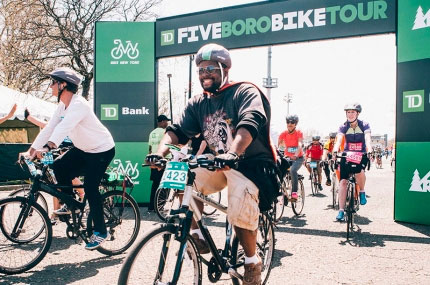 A rider crosses the finish line at the TD Five Boro Bike Tour.