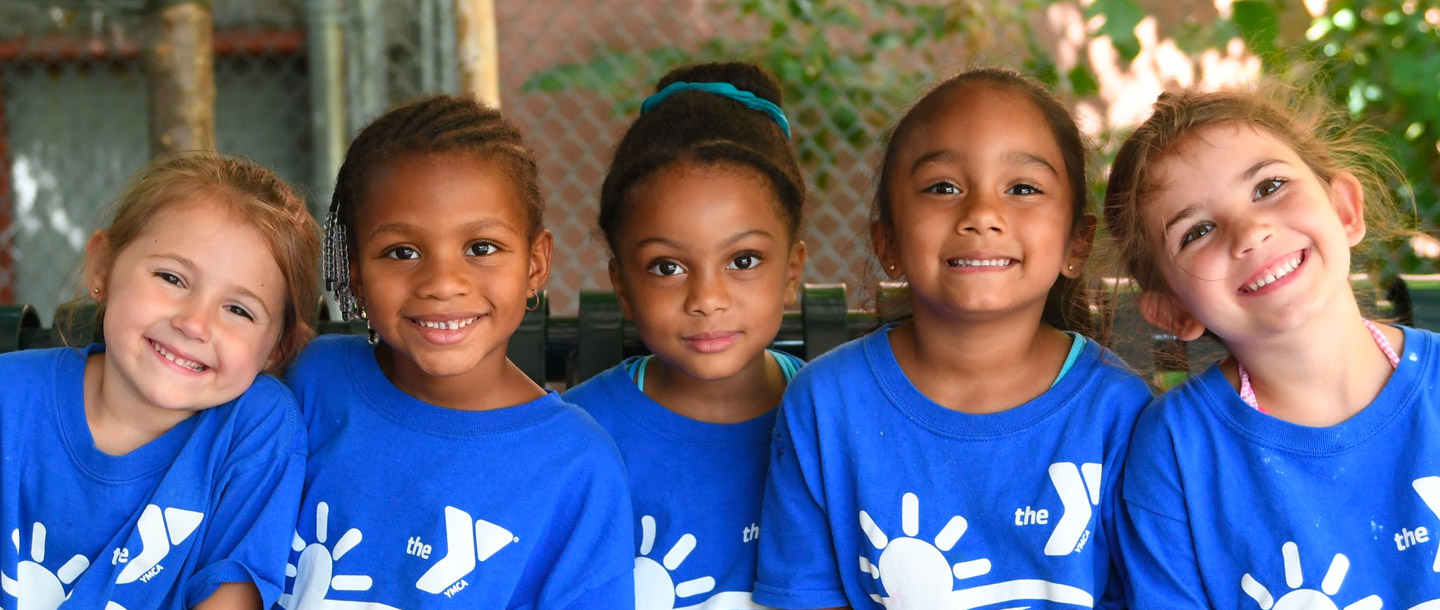 Five preschool girls outside at Dodge YMCA summer camp in Brooklyn
