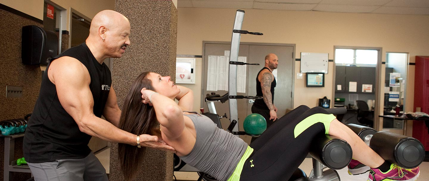 Personal trainer working with client at Broadway YMCA
