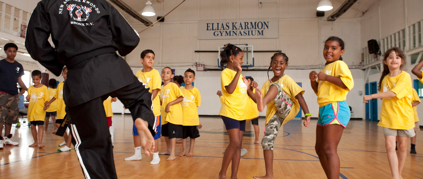Bronx YMCA summer campers learning marital arts in gymnasium