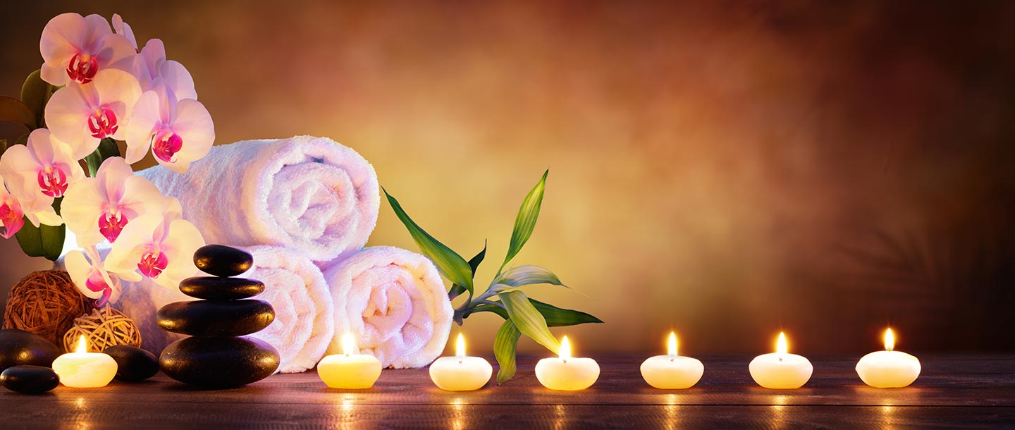 Flowers, towels and candles for massage therapy