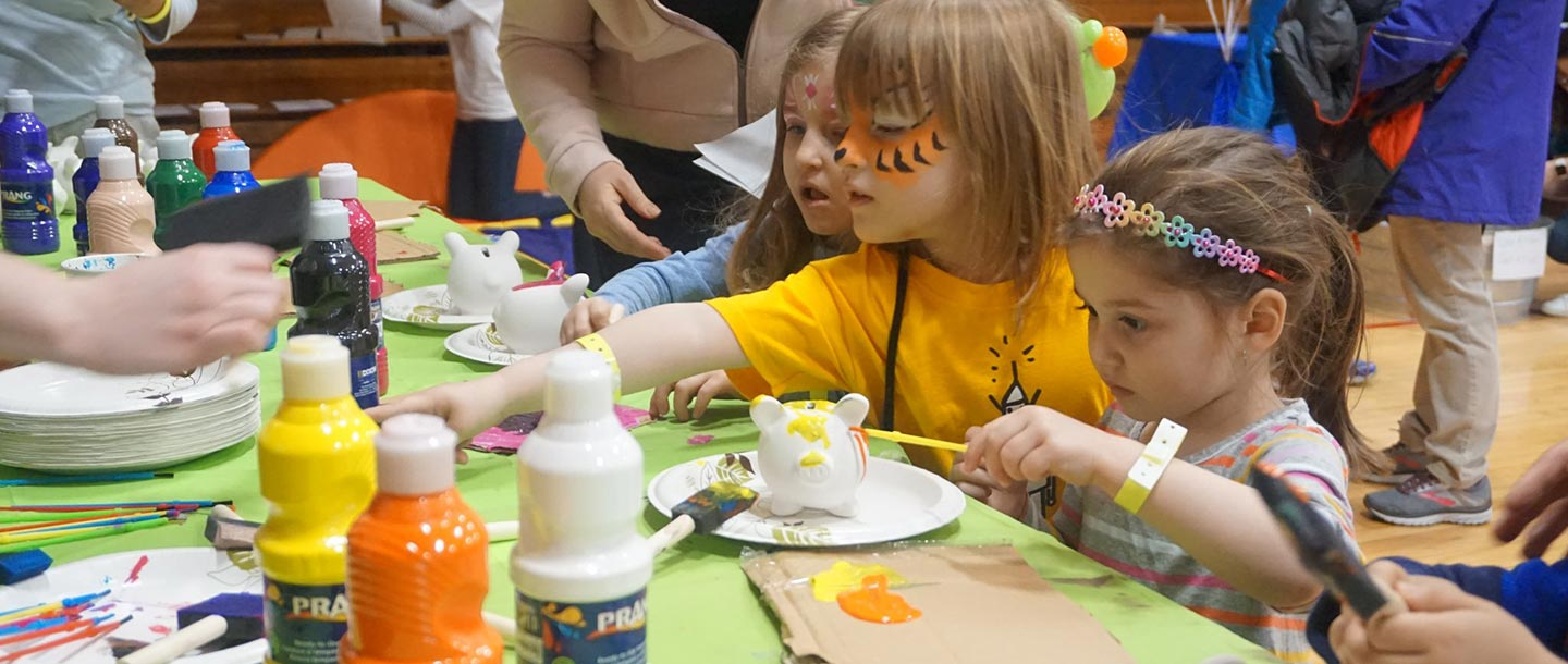 Kids doing arts and crafts with face paint at YMCA event free for family