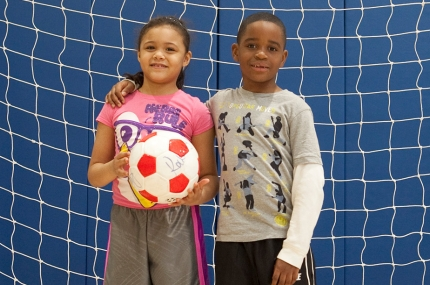 Kids learning soccer skills during youth sports class at the YMCA