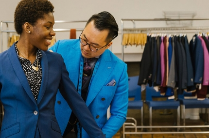 Y Step students are fitted for custom suits by Andrew Jang and Adriaen Black