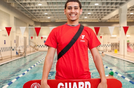 A lifeguard poolside at the YMCA.