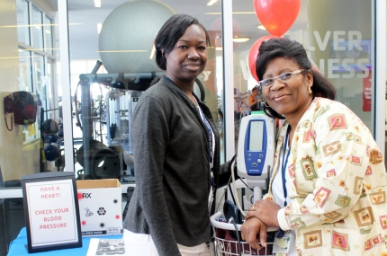 Two women with a blood pressure machine at the YMCA.
