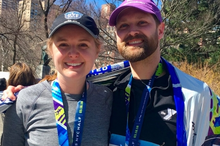A couple finishes the NYC half marathon as part of Team YMCA.