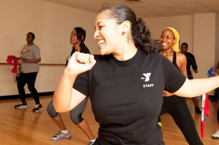 An instructor leads a zumba class at the YMCA.