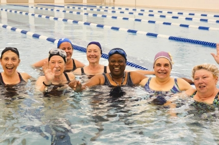 A group of swimmers in a water exercise class at the Y.