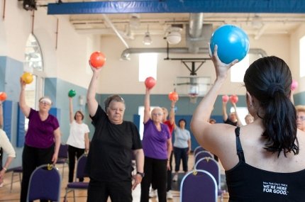 Seniors using equipment in chair yoga class at YMCA