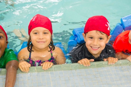 Summer campers swimming at YMCA