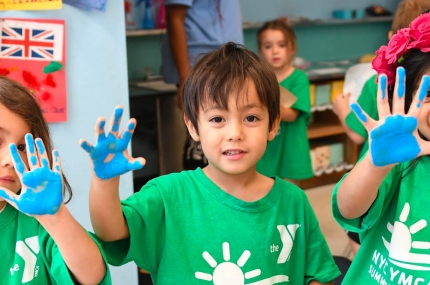 Summer campers with paint hands activity at YMCA day camp in Manhattan