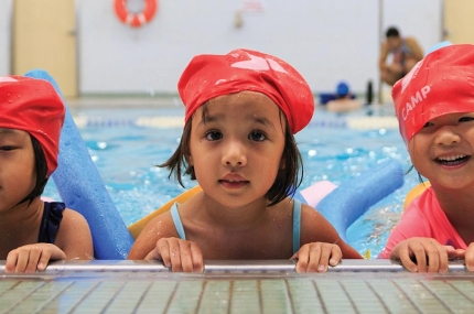 Preschoolers learn to swim at the YMCA