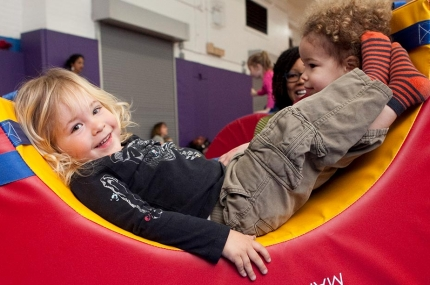 Toddlers playing in indoor YMCA gym