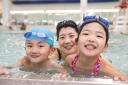 Family swimming at YMCA indoor pool