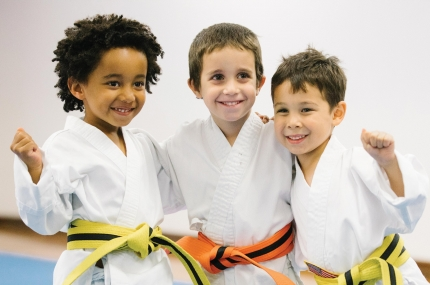 Three boys with karate belts at the Park Slope Armory YMCA