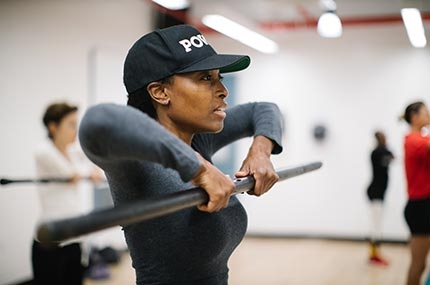 Woman lifting weight in strength training class for women at Bedstuy YMCA in Brooklyn
