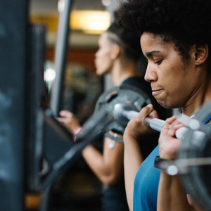 Woman lifting weights at Ridgewood YMCA in Queens