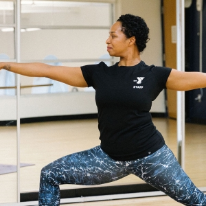 YMCA instructor demonstrating yoga warrior pose