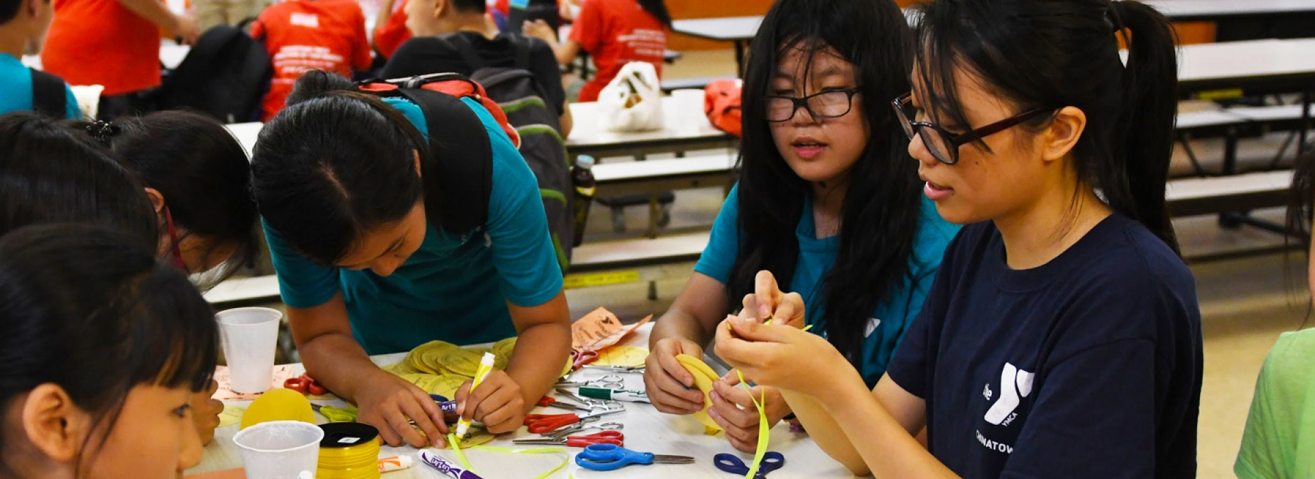 8c7f15888 Campers work on arts and crafts at the Chinatown YMCA summer day camp.